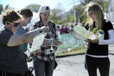 New friends from left, Adina Judovin, of New Jersey, Megan Tokarski, of Southbury, Denise Kelly, of Long Island and Erin Slockbower of California, look over maps that guide visiters to the different events in downtown Kent, Friday, Oct. 20, 2017, the first day of the three-day Gilmore Girls Fan Fest in Kent.