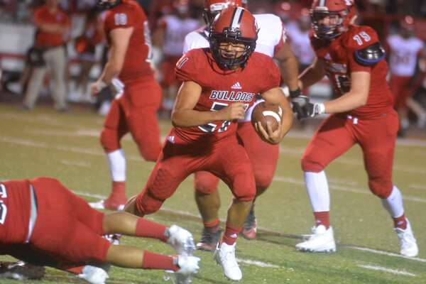 Plainview running back Jerrico Enriquez looks for running room during a game earlier this season. Enriquez scored a touchdown and had a 65-yard run in the Bulldogs' game against Amarillo High Thursday night.