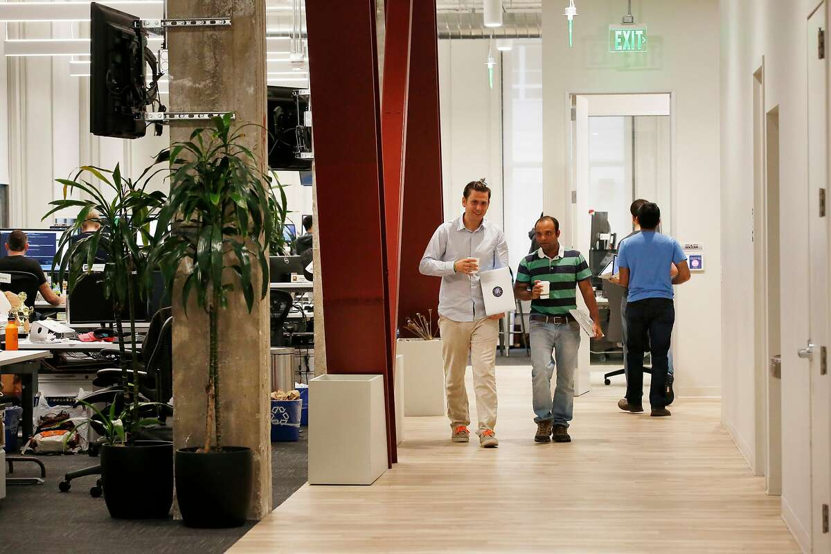 Sean Fannan (l to r) , co-founder Chartboost and Gaurau Sharma, engineering manager Chartboost, talk as they walk down a corridor while working at Chartboost on Thursday, October 19, 2017 in San Francisco, Calif.
