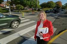 Norwalk Community College Chief Operating Officer Therese Marracco between the colleges two campuses on Richards Avenue Thursday, October 19, 2017, in Norwalk, Conn. The college will gain approximately 32 parking spaces along Richards Avenue in response to the school's request to slow traffic and provide some extra parking which is presently stretched to the limit.