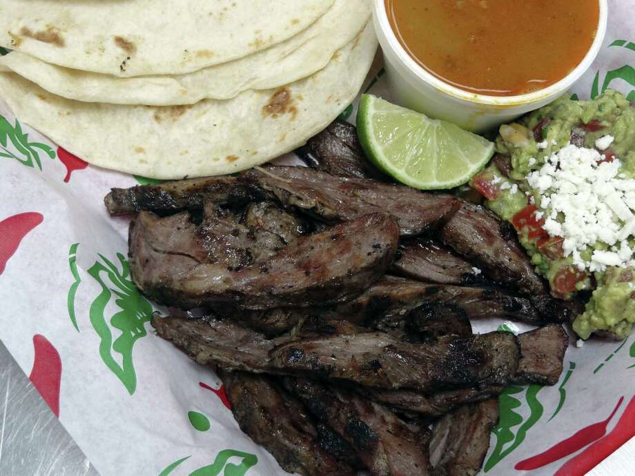 The fajita plate at the Salpicon Baja Street Grill in 2011. Yummy, but not so yummy was a scheme in which $1.2 million worth of fajita meat was delivered to a juvenile detention facility in Cameron County and then stolen over a nine-year period by an employee. Photo: BILLY CALZADA /SAN ANTONIO EXPRESS-NEWS / gcalzada@express-news.net