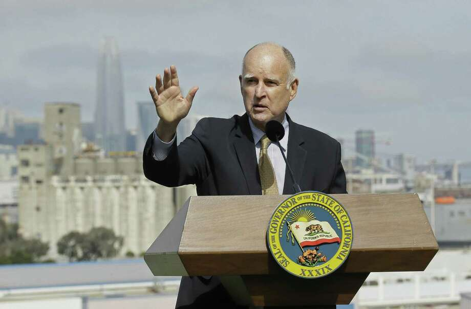 California Gov. Jerry Brown, shown speaking in San Francisco Wednesday on another matter, had threatened a veto if he didn't get amendments to the state's new sanctuary cities law. The result: not much sanctuary, local officials still cooperating with immigration authorities. Photo: Eric Risberg /Associated Press / Copyright 2017 The Associated Press. All rights reserved.