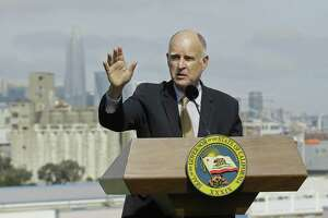 California Gov. Jerry Brown, shown speaking in San Francisco Wednesday on another matter, had threatened a veto if he didn't get amendments to the state's new sanctuary cities law. The result: not much sanctuary, local officials still cooperating with immigration authorities.