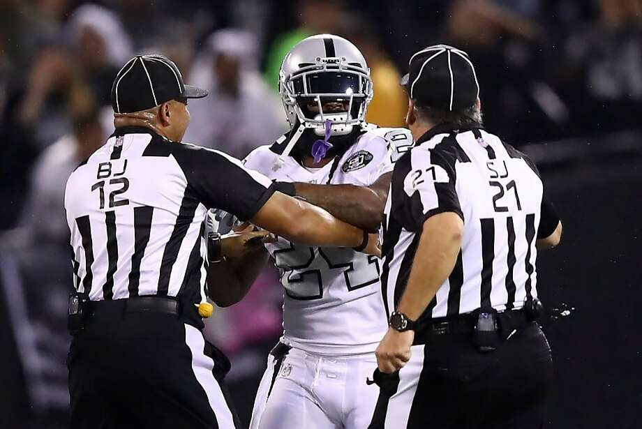 OAKLAND, CA - OCTOBER 19:  Marshawn Lynch #24 of the Oakland Raiders is restrained after coming off the bench and shoving a referee during a scrum with the Kansas City Chiefs in their NFL game at Oakland-Alameda County Coliseum on October 19, 2017 in Oakland, California. Lynch was ejected for unsportsmanlike conduct.  (Photo by Ezra Shaw/Getty Images) Photo: Ezra Shaw, Getty Images