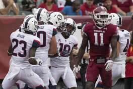 UConn offensive lineman Cam DeGeorge, second from left, has started every game this season as a redshirt freshman.