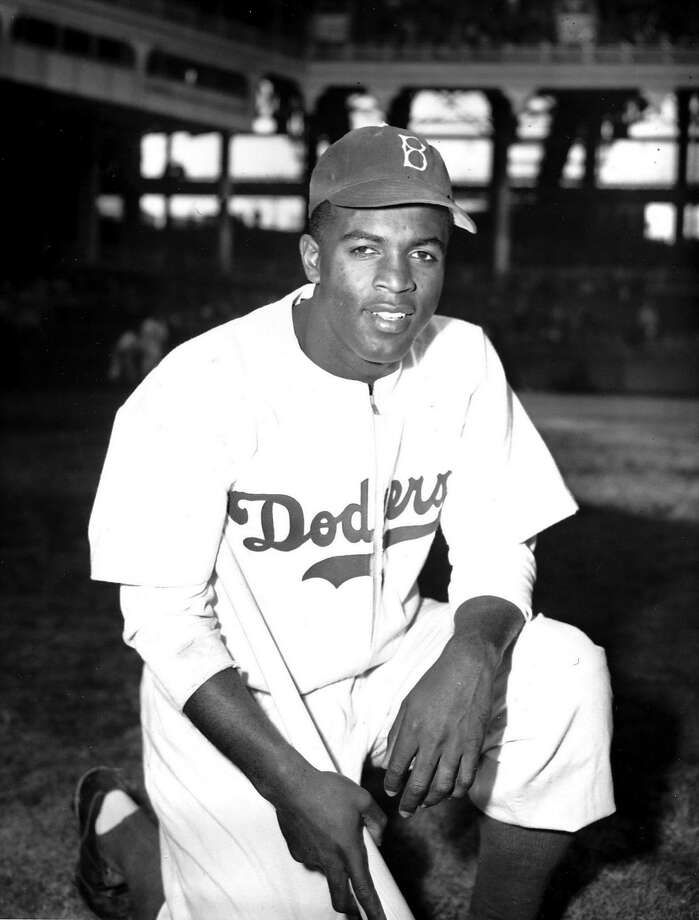 FILE - In this April 11, 1947 file photo, Jackie Robinson of the Brooklyn Dodgers poses at Ebbets Field in the Brooklyn borough of New York. Robinson's historic contract with the Brooklyn Dodgers that broke Major League Baseballs color barrier 69 years ago,  is on public view in New York. (AP Photo/John Rooney, File) Photo: JOHN ROONEY, AP