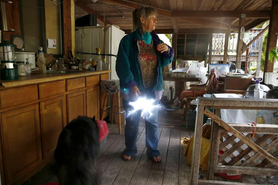 Susan Bostwick prepares to reset the electricity at her Sonoma County home as she returns on Friday following the wildfires. Photo: Liz Hafalia, The Chronicle