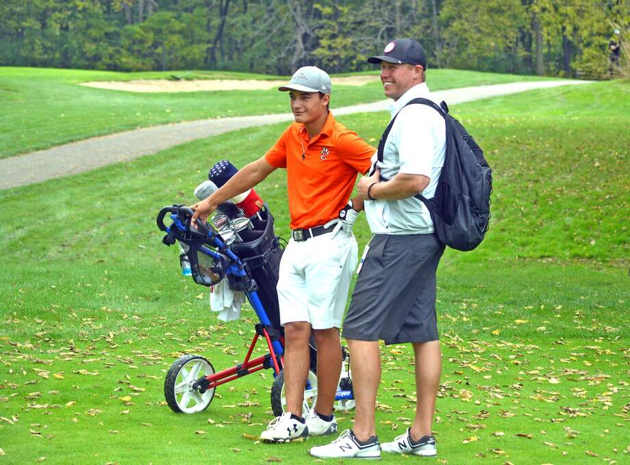 Edwardsville golfer Ben Tyrrell, left, and EHS coach Adam Tyler talk between shots on hole No. 6 at The Den at Fox Creek Golf Course in Bloomington during the second round of the Class 3A state tournament on Oct. 14.