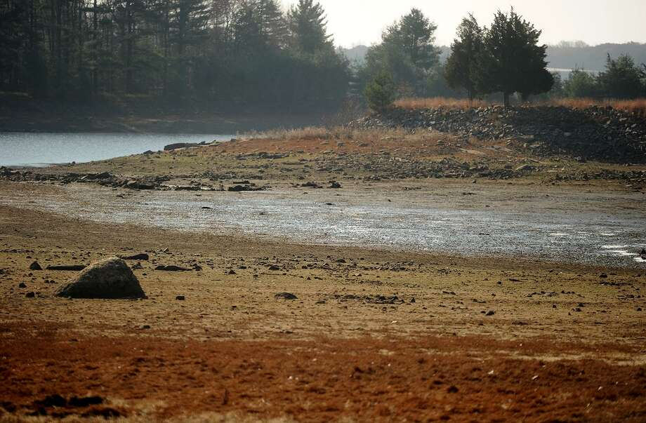 Low water levels at the Trap Falls Reservoir in Shelton, Conn. on Thursday, November 17, 2016. Drought conditions have continued in Connecticut for the last 29 months. Photo: Brian A. Pounds / Hearst Connecticut Media / Connecticut Post