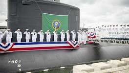 Sailors render a salute during the commissioning ceremony for the Virginia Class Submarine USS Washington (SSN 787) at Naval Station Norfolk.  Washington is the U.S. Navy's 14th Virginia-class attack submarine and the fourth U.S. Navy ship named for the State of Washington.