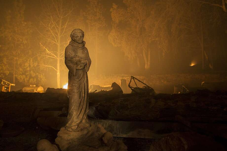 A statue stands next to the ruins of a house that burned in the Butte Fire in 2015, north of Murphys (Calaveras County). Photo: David McNew, Getty Images