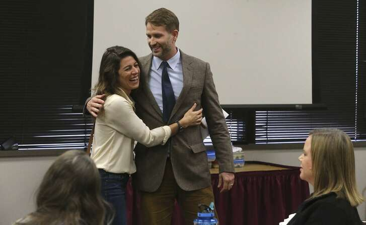 Erin Sprott (left), wife of Ryan Sprott (right) hugs her husband Friday October 20, 2017 after he received the James F. Veninga Outstanding Teaching of the Humanities Award and a check for $5,000 at a workshop session for teachers being held at the Education Service Center Region 20 Conference Center. Attended by U.S. Congressman Joaquin Castro, the award ceremony was held to recognize Sprott who received the highest rating from a panel of judges. Sprott teaches at the International School of ther Americas, a magnet program at NEISD's Lee High School.