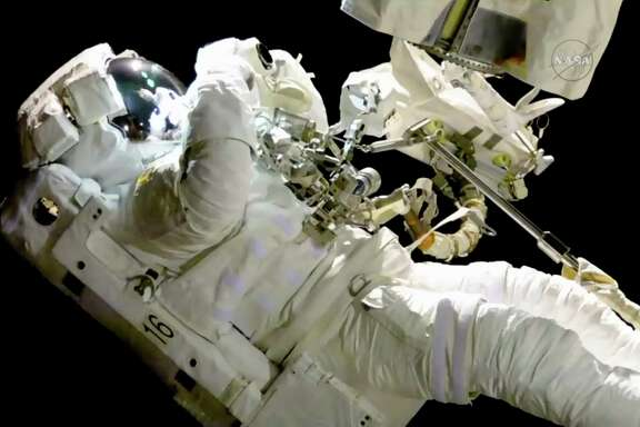 Joe Acaba on a spacewalk outside the International Space Station Friday. Acaba was outside an hour when he had to replace one of his safety tethers.