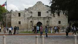"The new battle of the Alamo is being fought on the airwaves and via social media, with websites and resolutions, through protests and news conferences. As demonstrators carry signs saying, ""Save the Alamo,"" Land Commissioner George P. Bush is running campaign ads that say he's trying to do just that. After a vision of glass walls around the historic site shattered amidst protests, a proposal to move the Cenotaph is the latest rallying point for critics who say they'll work to oust Bush over the changes in the May 6 GOP primary. And they say San Antonio Mayor Ron Nirenberg also will face a political backlash. (Kin Man Hui/San Antonio Express-News)"