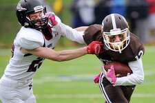 Brunwsick receiver Sean Amill, right, fights off a Salisbury defender during last year's game. Amill has 15 receptions for 248 yards and three touchdowns this year.