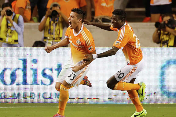HOUSTON, TX - JULY 25:  Leonel Miranda #33 and Rasheed Olabiyi #20 of the Houston Dynamo celebrate after Miranda scored a second half goal against the Los Angeles Galaxy at BBVA Compass Stadium on July 25, 2015 in Houston, Texas.  (Photo by Scott Halleran/Getty Images)
