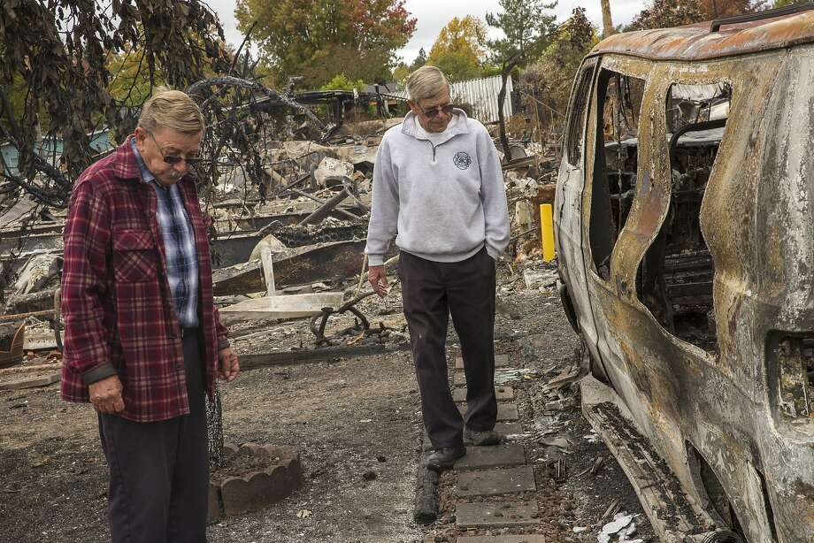 Jerry (left) and Charlie Wright — the two 73-year-old retired firefighters and twins helped keep the Tubbs Fire from spreading further west in Santa Rosa by grabbing hoses from a community clubhouse. Photo: Santiago Mejia, The Chronicle