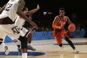 Isaiah Taylor of UT dribbles against Texas A&M on Nov. 25, 2015, in the Battle 4 Atlantis tournament in the Bahamas.