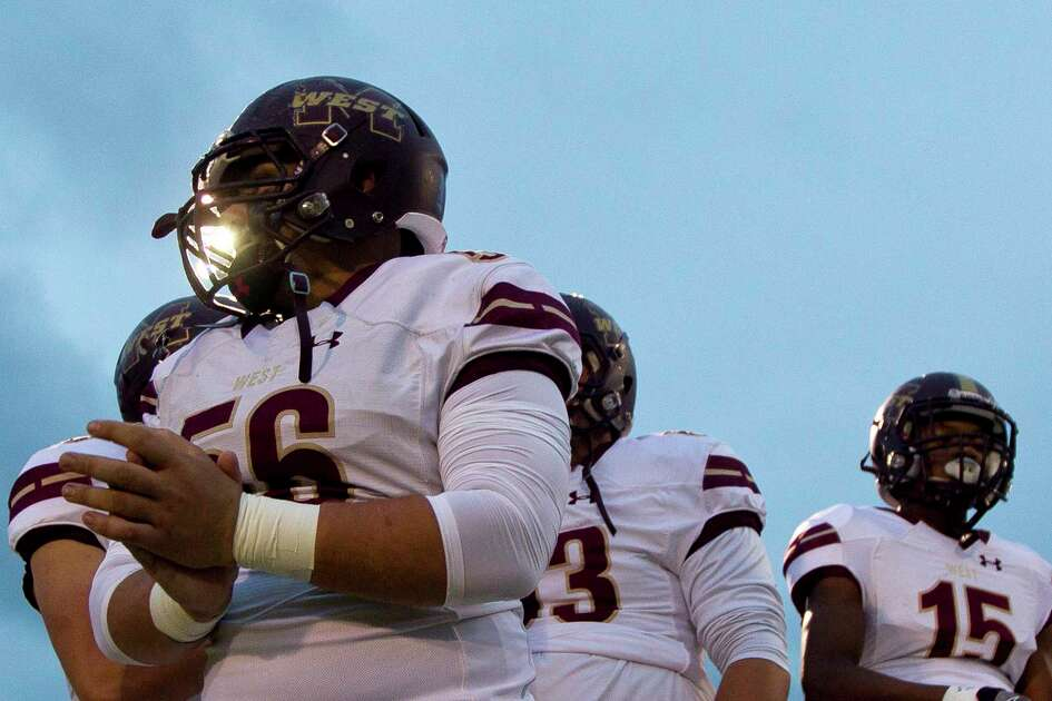 Magnolia West offensive linemen Logan Clarke (56) warms up before a District 20-5A high school football game against Magnolia, Friday Oct. 20, 2017, in Magnolia.