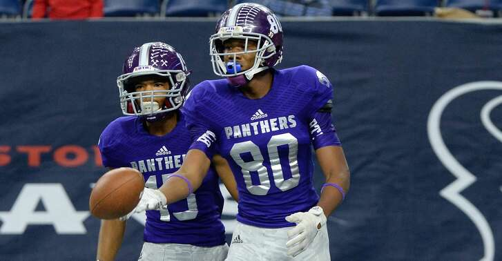 Ridge Point's Mustapha Muhammad, standing in the end zone with teammates Matt DeLeon (45) and David Packard (13), returns the ball to the official after scoring a touchdown against Crosby, Nov. 21 at NRG Stadium in Houston. The Panthers advanced to the regional quarterfinals. To view or purchase this photo and others like it, visit HCNpics.com.