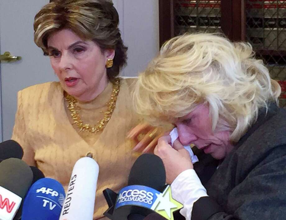 Heather Kerr, right, a former actress who alleges that entertainment mogul Harvey Weinstein sexually abused her in 1989, wipes her eye as her attorney Gloria Allred speaks to the media Friday in Los Angeles. Photo: Amanda Lee Myers, STF / Copyright 2017 The Associated Press. All rights reserved. This material may not be published, broadcast, rewritten or redistribu