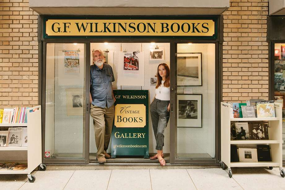 Rick Wilkinson and Natalia Kresich stand inside one of three window front panels that comprise G.F. Wilkinson Books at 34 Trinity Place in San Francisco, California, on October 11th, 2017. Wilkinson is transferring the lease on the bookstore to Kresich, originally a patron of the shop. He will continue to sell his stock out of one of the panels alongside Kresich, whose plans include hosting poetry readings by San Francisco based poets. Photo: Peter Prato, Special To The Chronicle