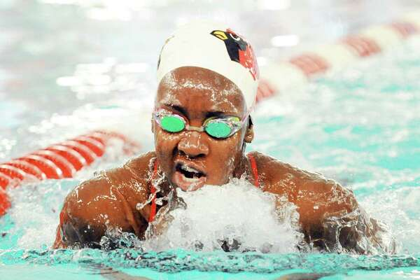 June Akpata of Greenwich swam the breast-stoke leg of the medley relay race during the girls high school swim meet between Greenwich High School and Staples High School at Greenwich, Conn., Friday, Oct. 20, 2017.