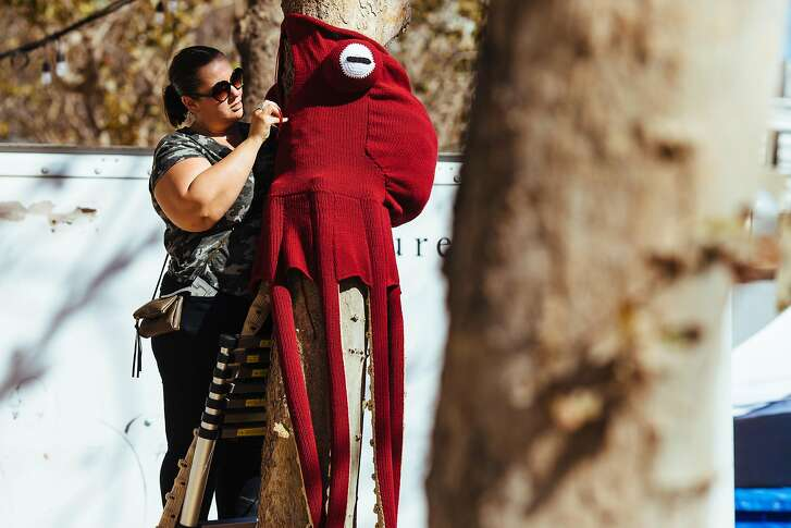 Lorna Watt sews the Giant Pacific octopus yarn bomb at the UN Plaza in San Francisco, Calif. Wednesday, October 4, 2017.