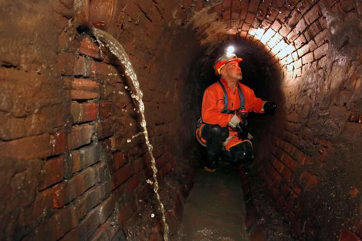 San Francisco Sewer serviceman Fred Gonzales inside the sewer system under the 300 block of Ellis St. which dates back to 1866, in San Francisco, as seen on Thursday October 12, 2017.
