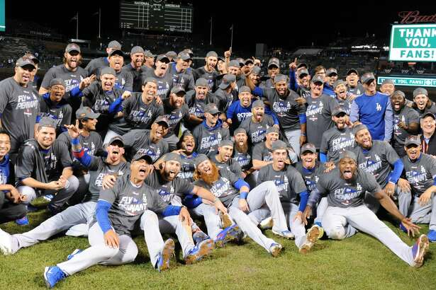 The Los Angeles Dodgers celebrate after an 11-1 series-clinching win against the Chicago Cubs in Game 5 of the National League Championship Series at Wrigley Field in Chicago on Thursday, Oct. 19, 2017. (Wally Skalij/Los Angeles Times/TNS)