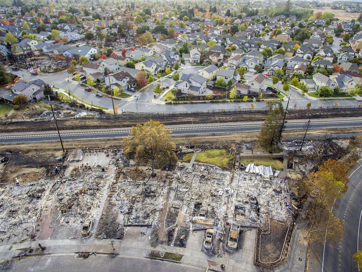 """The Coffey Park neighborhood was devastated by the Tubbs Fire, but the neighborhood off Gold Leaf Lane, across the """"line of sorrow,"""" has much less damage."""