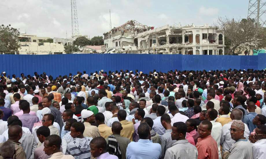 Thousands of Somalis gather to pray at the site of the country's deadliest attack and to mourn the hundreds of victims, at the site of the attack in Mogadishu, Somalia Friday, Oct. 20, 2017. More than 300 people were killed and nearly 400 wounded in Saturday's truck bombing, with scores missing. (AP Photo/Farah Abdi Warsameh) Photo: Farah Abdi Warsameh, STR / Copyright 2017 The Associated Press. All rights reserved.