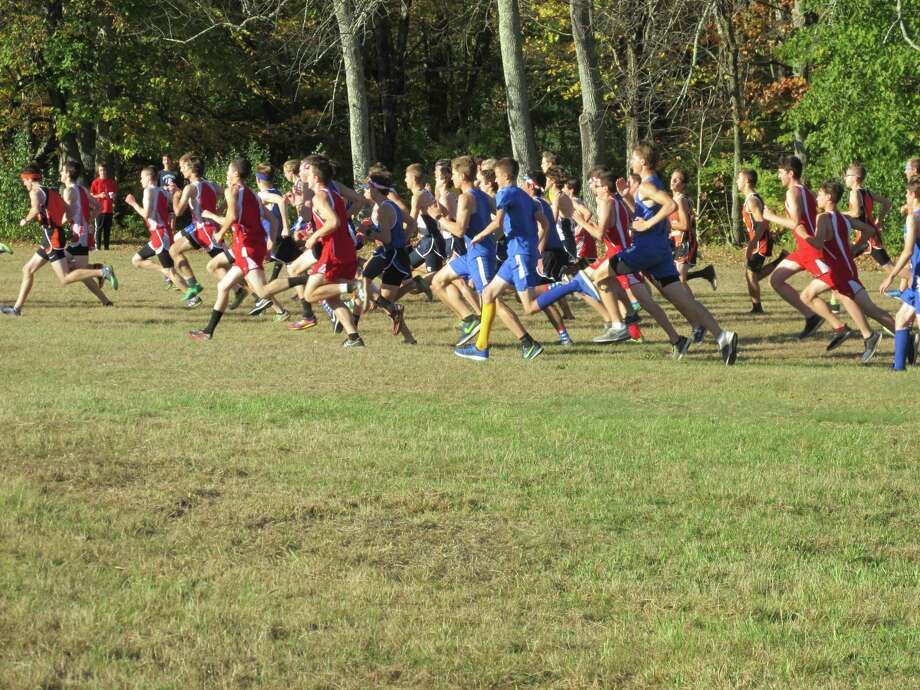 Terryville's Corey Picard jockeyed for position, then took the lead in the final 800 meters of the boys Berkshire League cross country championship Friday at Black Rock State Park. Photo: Peter Wallace