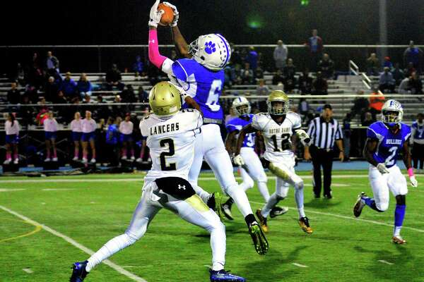 A pass intended for Notre Dame of Fairfield's Josh Tracey is intercepted by Bunnell's Elijah Alexandre during football action in Stratford, Conn. on Friday Oct. 20, 2017.