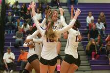 Members of the Westhill volleyball team celebrate after winning Game 1 against rival Stamford. Westhill went on to earn a thrilling 3-2 victory to claim the city championship Friday.