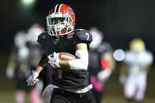 New Canaan Justin Greco sprints up field for a first half touchdown against Trinity Catholic in a FCIAC boys football game at Dunning Field in New Canaan, Connecticut on Friday, Oct.20, 2017.
