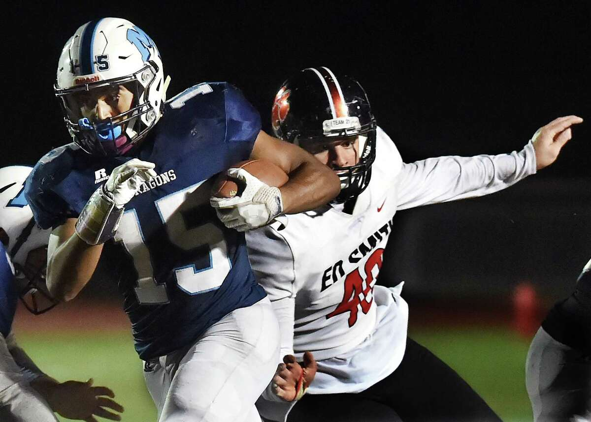 Middletown junior running back Xzavier Reyes avoids a tackle during Friday's game.