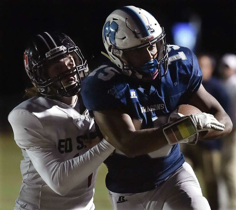 Middletown junior running back Xzavier Reyes avoids a tackle against E.O. Smith, Friday, October 20, 2017, at Rosek-Skubel Stadium at Middletown High School. Middletown won, 55-7. Photo: Catherine Avalone, Hearst Connecticut Media / New Haven Register
