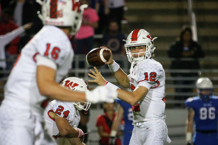The Woodlands quarterback Quinton Johnson (12) throws a pass to wide receiver Connor Klapesky (16) during the varsity football game against Oak Ridge on Friday, Oct. 20, 2017, at Woodforest Bank Stadium.