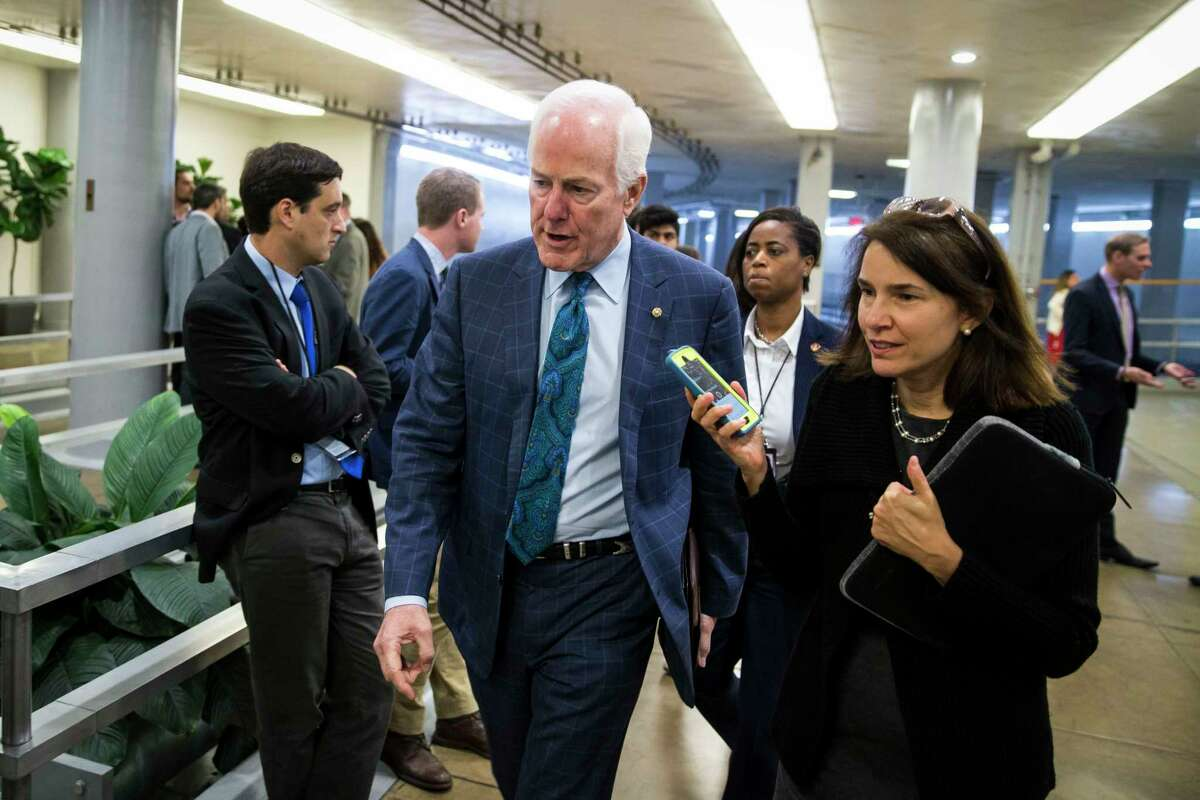 Sen. John Cornyn (R-Texas) arrives for a vote on budget resolutions on Capitol Hill in Washington Thursday. Cornyn placed a hold on an official's confirmation pending assurances Texas will receive more disaster funds.