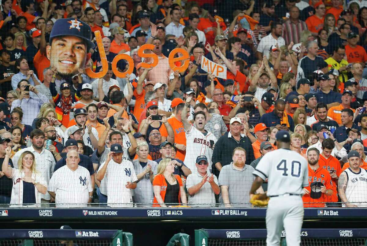 Astros fans celebrate as New York Yankees starting pitcher Luis Severino (40) leaves the field after a Houston Astros second baseman Jose Altuve (27) single drove in two runs in the fifth inning of Game 6 of the ALDS at Minute Maid Park, Friday, Oct. 20, 2017, in Houston.