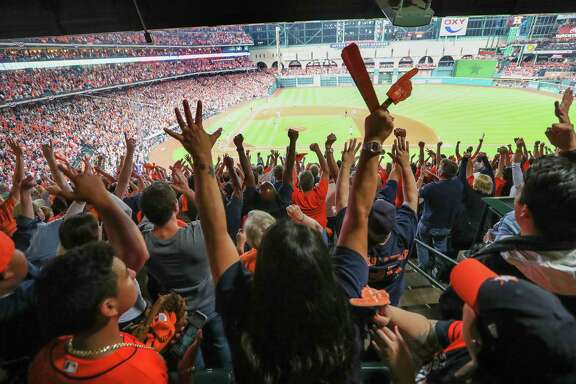 Astros fans erupts after Jose Altuve drove in two runs in the bottom of the 5th inning Friday, Oct. 20, 2017, in Houston.