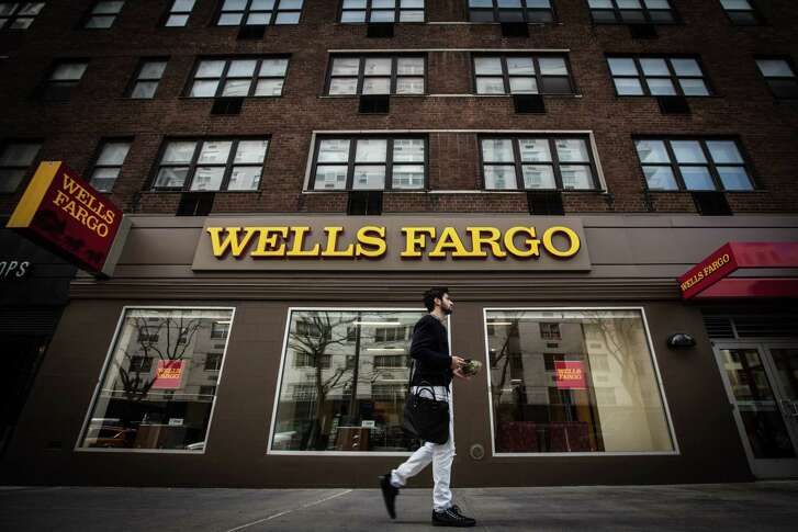 In an undated handout photo, a Wells Fargo branch in New York. A confidential report sent to Well Fargo in October of 2017, prepared by the Office of the Comptroller of the Currency and reviewed by The New York Times, criticizes the bank for forcing hundreds of thousands of borrowers to buy unneeded auto insurance when they took out a car loan, as well as its handling of the problems once they were detected. (Ali Asaei via The New York Times) -- NO SALES; FOR EDITORIAL USE ONLY WITH WELLS FARGO REPORT BY GRETCHEN MORGENSON FOR OCT. 21, 2017. ALL OTHER USE PROHIBITED. --