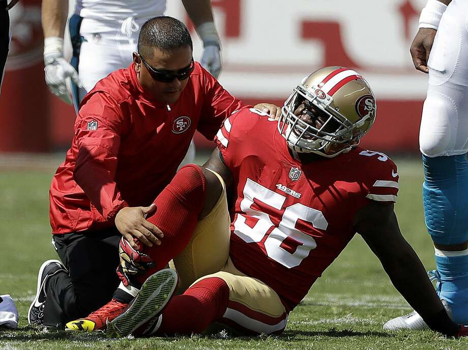 FILE - In this Sept. 10, 2017, file photo, San Francisco 49ers linebacker Reuben Foster (56) is tended to by a trainer after getting injured during the first half of an NFL football game against the Carolina Panthers in Santa Clara, Calif. The 49ers are hoping to get the talented rookie linebacker back this week after a sprained ankle sidelined him since the season opener. (AP Photo/Marcio Jose Sanchez, File) Photo: Marcio Jose Sanchez, Associated Press