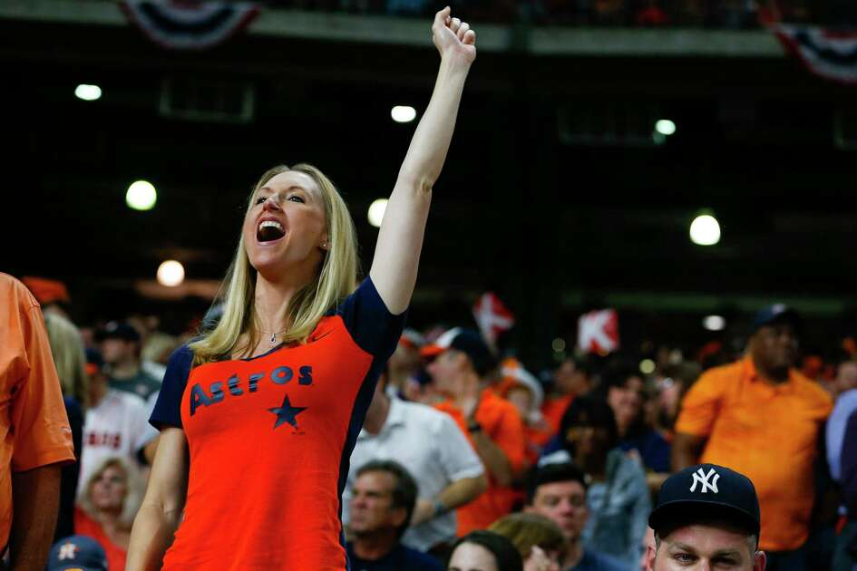 A fan cheers during the fourth inning of Game 6 of the ALCS at Minute Maid Park on Friday, Oct. 20, 2017, in Houston.