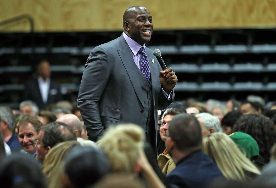 """Los Angeles' Lakers' Magic Johnson discusses the """"Business of Basketball"""" in a talk moderated by Golden State Warriors' Rick Welts at University of San Francisco War Memorial Gym in San Francisco, Calif., on Wednesday, October 18, 2017. Photo: Scott Strazzante, The Chronicle"""