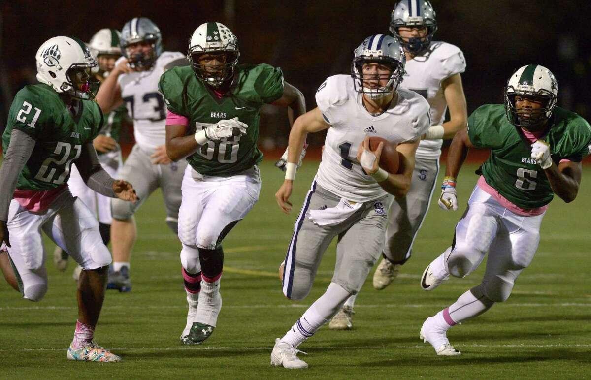 Staples' #10 Harris Levi breaks away for yardage as the Staples High School football team takes on Norwalk High School Friday, October 20, 2017, in Norwalk, Conn.