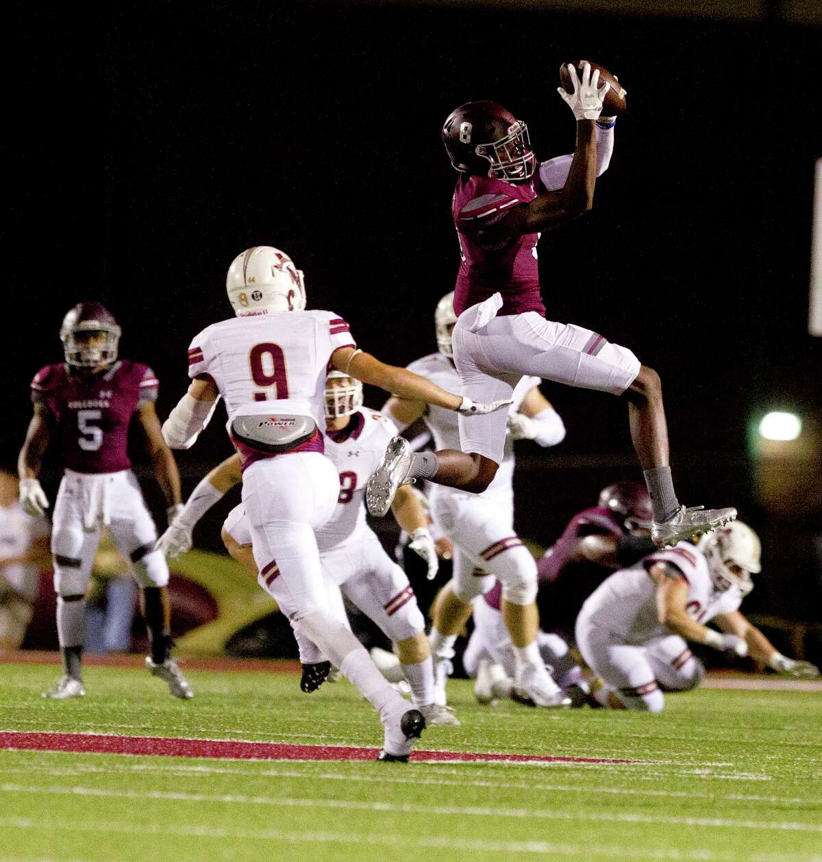Magnolia wide receiver Michael Woods (8) catches a high pass from quarterback Reese Mason during the first quarter of a District 20-5A high school football game, Friday Oct. 20, 2017, in Magnolia.