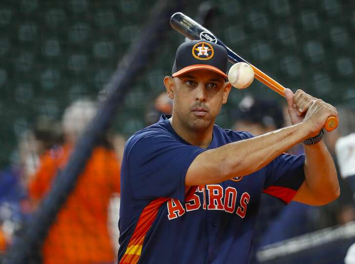 Houston Astros bench coach Alex Cora (26) warms up the Atros infield before the first inning of Game 6 of the ALDS at Minute Maid Park, Friday, Oct. 20, 2017, in Houston. ( Karen Warren / Houston Chronicle )