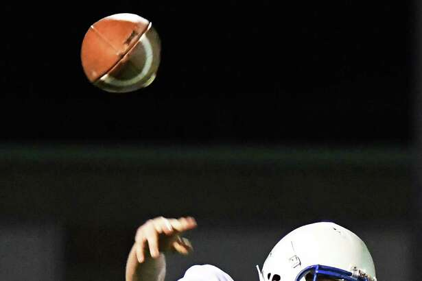 Hoosick Falls QB #8 Sam Richard throws a pass during Friday Night's game against Watervliet Oct. 20, 2017 in Watervliet, NY.  (John Carl D'Annibale / Times Union)